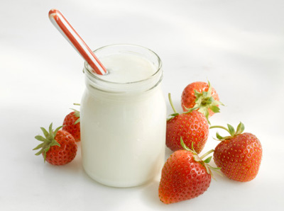 Jar of yoghurt and fresh strawberries