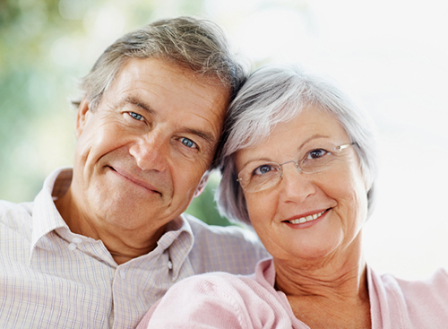 Closeup portrait of a smiling cute senior couple sitting together